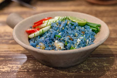 Fried Blue rice from petal of butterfly pea flowers Stock Photo