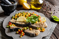 Fried blue shark with steamed vegetable stock images