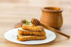 Fried bread croutons with honey Royalty Free Stock Photo