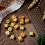 Fried bread cut into cubes  cooking. Royalty Free Stock Images