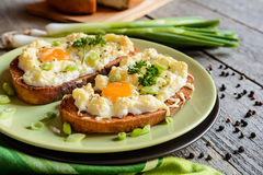 Fried bread with eggs, cheese and onion Stock Images