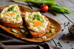 Fried bread with eggs, cheese and onion Royalty Free Stock Image