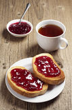 Fried bread with jam and tea cup Stock Photography