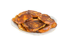 Fried bread in the milk on a plate Royalty Free Stock Photo