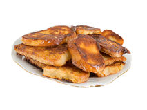 Fried bread in the milk on a plate Royalty Free Stock Photos