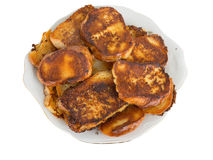 Fried bread in the milk on a plate Stock Images