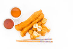 Fried bread stick or You Tiao served with Chinese tea. Royalty Free Stock Photos