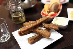 Fried bread sticks with garlic Stock Photo
