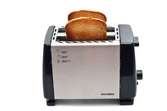 Fried bread in the toaster Stock Photos