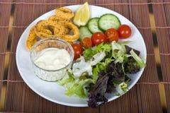 Fried breaded calamari meal Stock Image