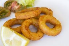 Fried Breaded Calamari with salad Stock Photos