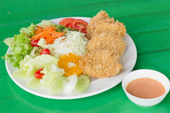 Fried breaded chicken Milanese with Salad Stock Photos