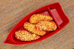 Fried breaded chicken on red graceful plate on japanese napkin stock photo