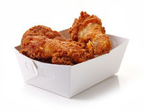 Fried breaded chicken in white cardboard box. Isolated on white background Royalty Free Stock Image