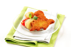 Fried breaded fish with potatoes Stock Images