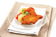 Fried breaded fish with potatoes Stock Photo