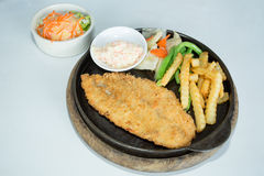 Fried breaded fish steak Stock Photo