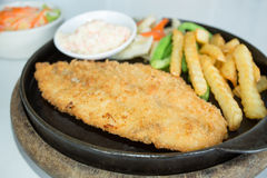 Fried breaded fish steak Stock Photos