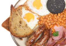 Fried Breakfast. Full English cooked breakfast with fried bread, black pudding and baked beans Stock Images