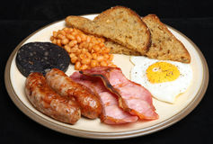 Fried Breakfast. Traditional full English cooked breakfast with baked beans and black pudding Royalty Free Stock Image