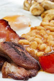 Fried Breakfast. With bacon, beans, tomatoes, egg and mushroom. Typically English stock images