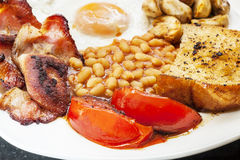 Fried Breakfast. With bacon, beans, tomatoes, egg and mushroom. Typically English stock photos