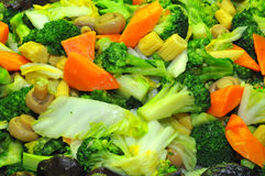 Fried Broccoli. Serving Of Fried Broccoli With Red Carrot And Button Mushroom Stock Image