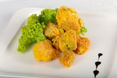 Fried broccoli. With salad leaves royalty free stock images