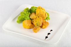 Fried broccoli. With salad leaves royalty free stock photography