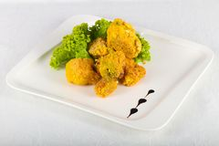 Fried broccoli. With salad leaves royalty free stock image