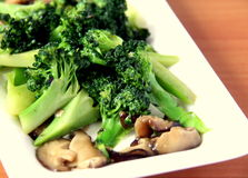 Fried broccoli with mushroom. Chinese style fried broccoli with mushroom Stock Image