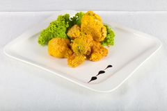 Fried broccoli. With salad leaves royalty free stock photo