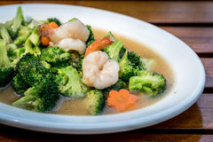 Fried brocoli with shrimp. In White ceramic dish royalty free stock photography