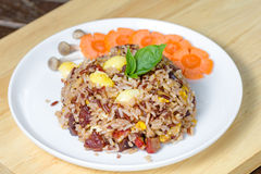 Fried brown rice. With vegetables and fried eggs Stock Image