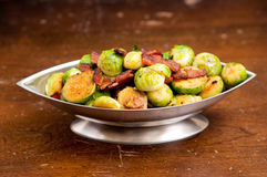Fried brussel sprouts with chopped bacon Royalty Free Stock Photo