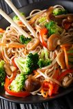 Fried buckwheat soba noodles with mushrooms and vegetables close Royalty Free Stock Image
