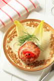 Fried burger and endive leaves Royalty Free Stock Photo