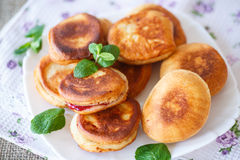 Fried cakes with jam. Decorated with mint Stock Photography
