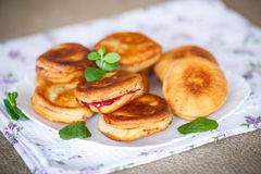 Fried cakes with jam Stock Images