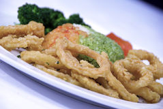 Fried calamari. Deep fried calamari with broccoli and mixed rice Stock Photos