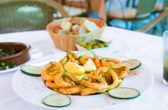 Fried calamari in restaurant. Fried calamari in the restaurant Royalty Free Stock Photos