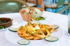 Fried calamari in restaurant. Fried calamari on white plate in restaurant Royalty Free Stock Photos