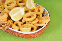 Fried calamari rings dipped in batter with lemon Stock Photography