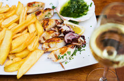 Fried calamari served with fries at a restaurant royalty free stock photos