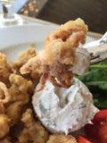 Fried calamari served with sauce and salad Stock Photos