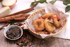 Fried Calamari. Fried squid fried calamari, calamari is a dish in Mediterranean cuisine. It consists of batter-coated, deep fried squid, fried for less than two royalty free stock photography
