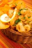 Fried calamari with Sweet potato chips Royalty Free Stock Photos
