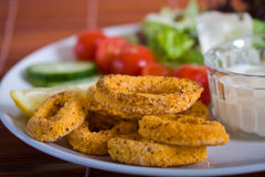 Fried calamari with vegetables Royalty Free Stock Images
