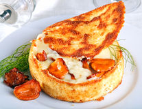 Fried camembert with chanterelles Stock Photos