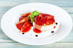 Fried camembert cheese with pears and berry sause stock images
